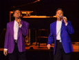 See video of Chris Hudson and Doug Saleeby on stage singing for an audience - requires free Real Audio player